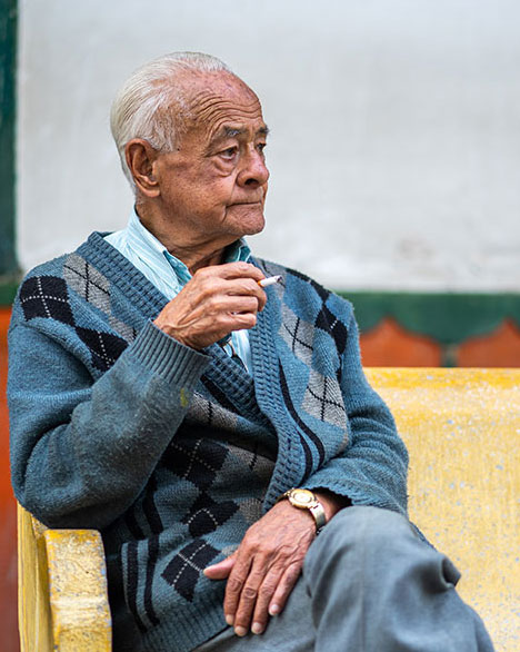 Elderly Man Sitting with a Cigarette
