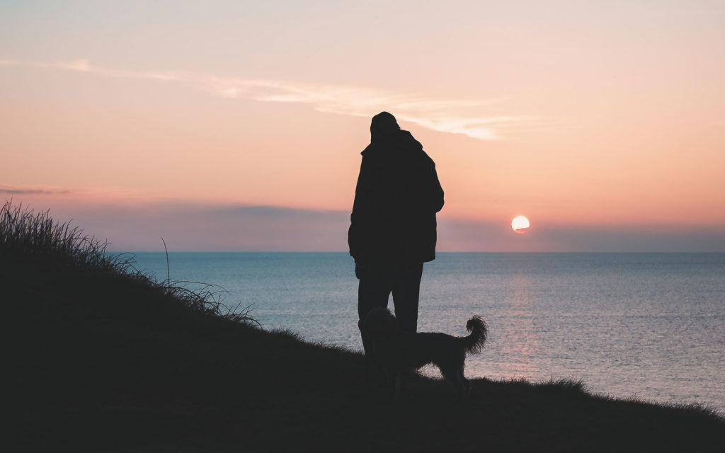 Man with Dog at the Coast