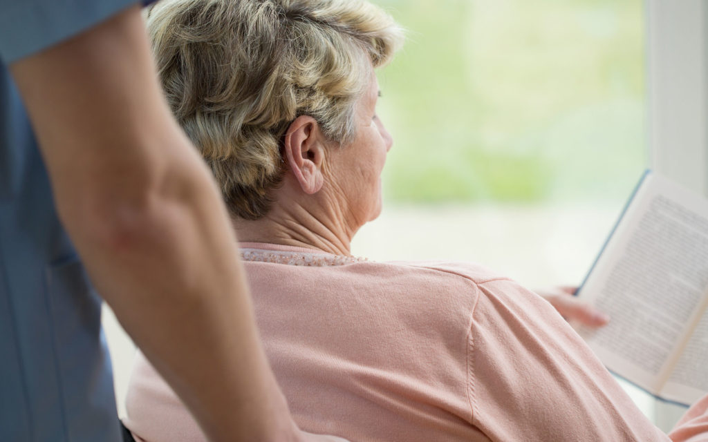 Elderly Person Reading
